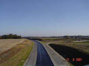 Die photorealistische Abbildung zeigt einen Straßenabschnitt der Flughafentangente.