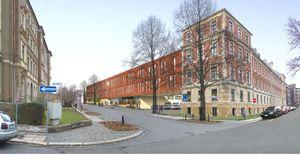 Die Abbildung zeigt das Landgericht im Vordergrund sowie den geplanten Neubau in einer perspektivischen Ansicht.